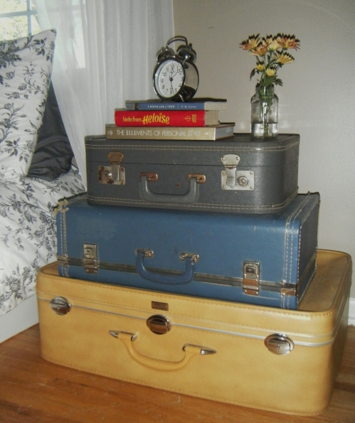 stacked suitcases as bedside table
