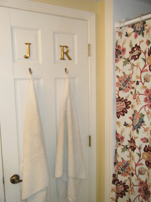 letters above shower hooks