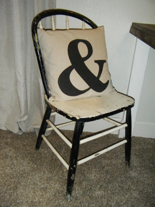 chippy chair with ampersand pillow