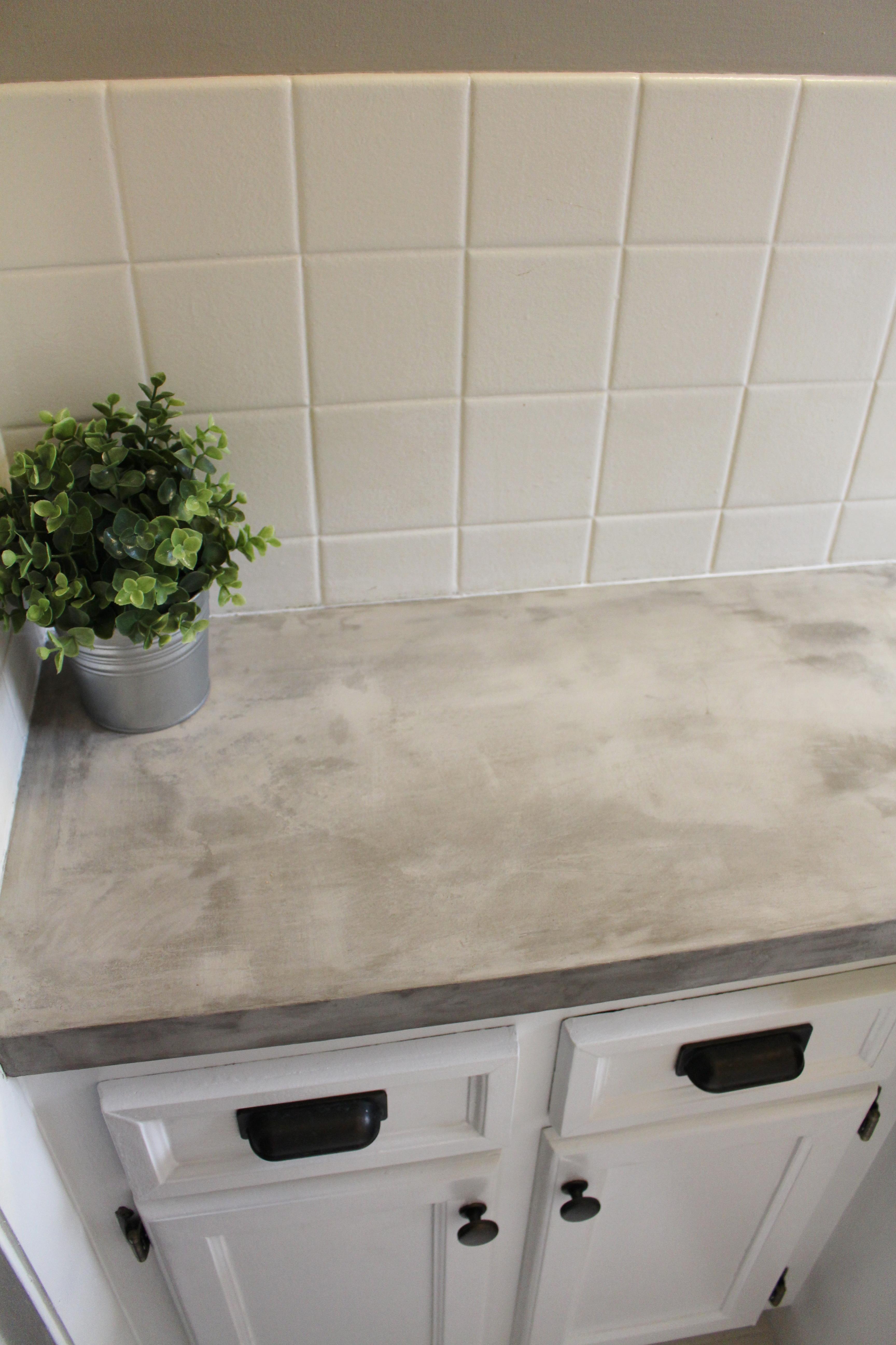 bathroom makeover + DIY concrete counters | simply chic.