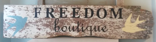 freedom boutique sign